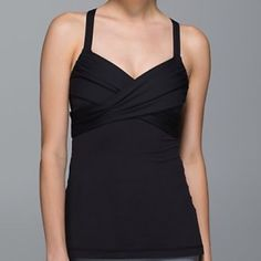 Lululemon wrap it up tank 4 black Lightweight  mesh body tank with racer back built-in bra that has optional removable cups included. Medium coverage and support for C/D cups. Tight fit, hip length. Size 4. Black color. No trades please. lululemon athletica Tops Tank Tops