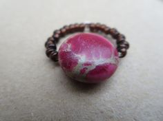 Hey, I found this really awesome Etsy listing at https://www.etsy.com/listing/198945920/pink-gemstone-bead-ring-jasper-beaded