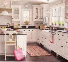 White kitchen ... pale blue walls ... black counters