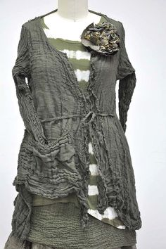 Features:   Lovely dress with asymmetrical hem  Can be worn as a jacket…