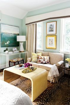Aesthetic Oiseau: Traditional Twist in Richmond,  Designed by Charlotte Lucas, Photos by Laurey Glenn for Southern Living, blue walls, bedroom with sitting area, waterfall coffee table, pelmet box over two windows, lucite desk console, anetelope rug