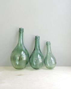 Handblown green glass bottles would make an excellent addition to a vignette. #LocalMilk