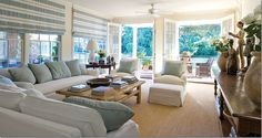 family room: simple white slipcovers and blue pillows