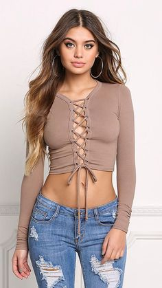 92c33422c17c Pretty little lace up! A stylish crop top in a jersey knit bodice solid all  throughout. Features a plunge neckline with thin lace up straps.
