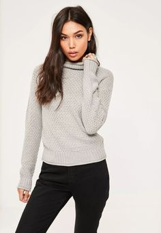 Get cosy when the chill sets in with this chic high neck jumper.