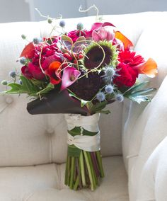 Gorgeous Jewel Tone bouquet in rich fuchsia, blue thistle, hand tied handle.