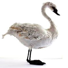 Whooper Swan made by Abigail Brown, a completely hand made sculpture: stuffed fabric body with textile feathers, beak and legs on wired feet. Available at The Shop Floor Project.