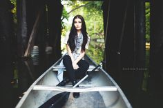Creative portrait photography editorial fashion shoot with canoe in Minneapolis, Minnesota on Lake Calhoun. Senior photo idea and engagement idea by: Andrew Saxum Photography