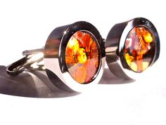 A personal favorite from my Etsy shop https://www.etsy.com/listing/122847627/mens-cufflinks-3d-red-hot-chili-pepper