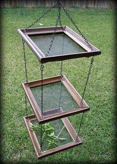 Picture frame, plain mesh screen and simple chain. Hang from booth ceiling for lightweight tray display pieces. Market Day Craft Show Booth Display Idea | best stuff