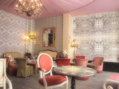 """""""Macarena""""wallpaper on left - Carnets Andelous collection - Cristian Laxcroix. """"Bumblebee"""" & """"Acanthus"""" wallpapers in centre - Farrow & Ball. """"Riflesso"""" wallpaper on right - Fornasetti collection by Cole & Son. Tented ceiling"""