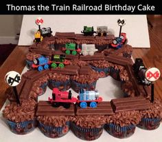 Use Kit Kats on top of chocolate frosted cupcakes for a Thomas the Train birthday cake. Easy and cute!
