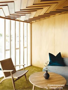 The houndstooth-style ceiling in this unique New Zealand home was designed to evoke a traditional Maori cloak. It's a warm, woven canopy that shelters the house and family.