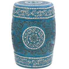 An ornate, Moroccan-style design adorns this handcrafted porcelain garden stool. Curling, white vines frame the top and bottom, while the center features a radiant floral medallion encircled by twirling, steel-grey ivy and an opulent, peacock blue glaze.