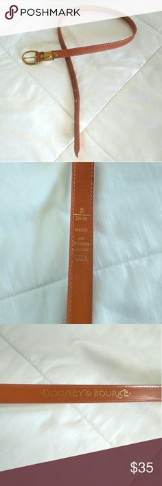Dooney & Bourke women's leather belt Excellent condition, all weather leather rare belt. Tan colored with gold accents on buckle and classic D&B logo. Women's size small, length 26-28 Dooney & Bourke Accessories Belts