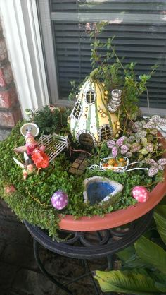 Fairy garden for a window sill...perfect. Maybe a small strand of twinkle lights around it.