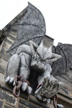 One of the two gargoyles that guard the entrance above the Eastern State Penitentiary Philly, Pa