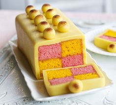 Simnel Battenberg cake. This stunning Easter bake has pink and yellow squares of light sponge, sandwiched with apricot jam and is topped with balls of marzipan