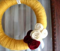 yarn wrapped wreath w/ felt flowers