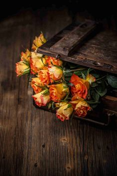 Buy Bouquet of orange roses by grafvision on PhotoDune. Bouquet of orange roses on a vintage wooden background