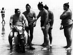 Sumo wrestler on a motorcycle- black and white photography in Japan?