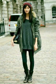 Oversized grey sweater + red beanie green parka + black leggings + combat boots