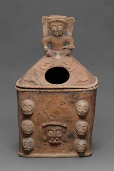 K'iché burial or cache urn lid | Dated A.D. 650–850 Dimensions 53 x 64 x 44 cm (20 7/8 x 25 3/16 x 17 5/16 in.) Medium Earthenware: white, blue and black post-fire paint Collections Americas Classifications Ceramics Culture Maya Object Place Southern Highlands Guatemala Period Late Classic Period