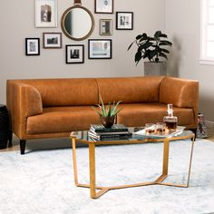 Enrich your home decor with the rustic charm of the Nimbus Charme Russett Leather Sofa. Constructed from premium leather, this modern sofa features clean lines and a warm brown upholstery color.