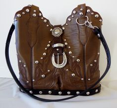 Just in time for Country Thunder.  Western fans get your cowgirl on with this StageCoach Bag created from a Lucchese boot.  The scalloped tops are just too cute.  www.stagecoachbagsandcollectibles.com