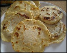 Pupusas are a deLish treat fro El Salvador. This redCipe says they are kinda hard to make,but I find them much easier than making corn tortillas or sopes. Soooo good. Be sure to look up a 'curtido' recipe to go with it. Yuuummmmm(10)
