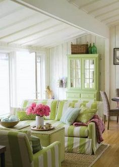 Cottage Living Room In Green Stripes Of Leaf And Butterscotch Yellow Compliment Pink Flower Showpiece As Decor All Such Colors Adds