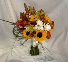 Autumn Bridal bouquet. (Gerbera daisies will be used instead of sunflowers.)  #RoseOfSharon