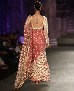 http://www.exclusively.com/dark-old-rose-sari-with-embroidered-motifs-v-anm18nov14e12-anju-modi