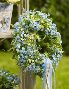 Forget me not wreath...would be pretty for the front doors of the barn!