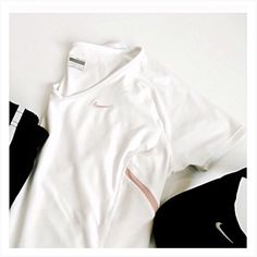 """Nike • Athletic • Top Great athletic top, white with pink trim.  🔶Brand • Nike.  🔶Size • Medium, but fit is a bit smaller, tagged as a Small.  🔶Chest • 16"""".  🔶Length • 24"""".  🔶Fabric • 92% polyester, 8% spandex.  🔶Condition • beautiful condition. Nike Tops Tees - Short Sleeve"""