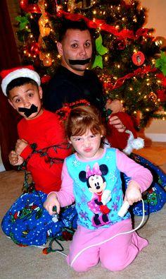 Funny Christmas pictures   Season's Greetings   Santa Hats:$8.00   Black Tape:$3.00   Silent Night: PRICELESS