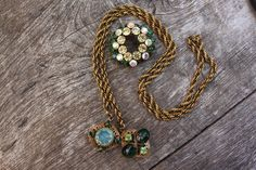 Elsa Schiaparelli lariat of Russian gold and gorgeous foil glass cabachons and irridescent glass with crystals. Stunning and RARE piece. The brooch is Austrian.