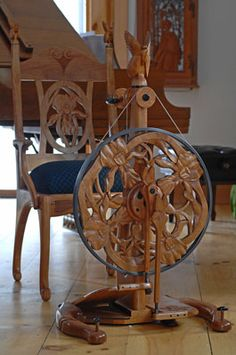 The Butterfly & Orchid : Golding hand carved spinning wheel