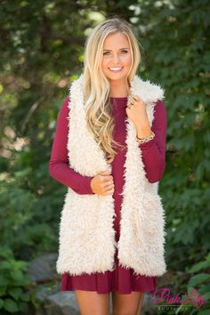 You'll love wearing this wonderfully soft vest all season long - it's sure to go everywhere with you! Featuring an irresistibly soft ivory faux fur material, this adorable vest is just the perfect fall layering piece!