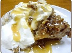Praline Pecan Bread Pudding with Rum Sauce Recipe - Oh, my! I've been known for my bread pudding (especially the one with white chocolate and macadamia nuts), but this recipe will take it up another notch!!
