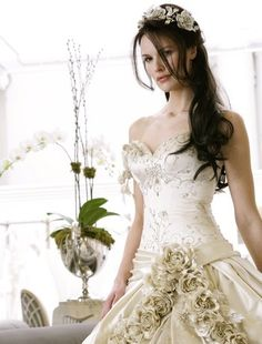 Pnina Tornai wedding dress with champagne detailing
