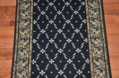 """Dean Washable Carpet Rug Runner - Trellis Black - Purchase By the Linear Foot by Dean Flooring Company. $10.00. This runner is sold here by the linear foot. One unit of quantity equals one foot of length on your runner. Width - Approximately 25"""". These beautiful carpet runners match our Dean Flooring Company stair treads. This item will be finished (serged with color matching yarn) on all four sides regardless of the length. It is made from nylon with a washable non-skid rubber back."""