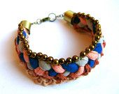 Braided and crocheted bracelet in blue, coral and grey.
