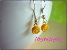 Lemon slices!  https://www.etsy.com/listing/154517262/lemon-earrings?ref=shop_home_active