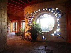This delightful window comes via my natrual building friend Sigi Koko Build Naturally with Sigi Koko and is by way of New Zealand and Graeme North architect. Very inspiring www.ecodesign.co.nz www.cordwoodconstruction.org