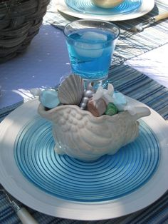 Blue Glass and Seashell Tablescape for a Beach Themed Wedding