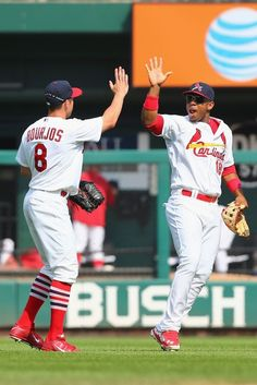 ST. LOUIS, MO - AUGUST 3: Peter Bourjos #8 and Oscar Taveras #18 of the St. Louis Cardinals celebrate after defeating the Milwaukee Brewers ...