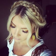 10 Pinterest Hairstyles for Homecoming |  This milkmaid braid with face framing pieces is the perfect medium between stylish and sophisticated.