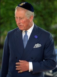 Prince Charles wearing a yarmulke arrives for the Installation of the New Chief UK Rabbi Ephraim Mirvis St John's Wood Synagogue in London
