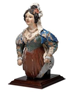 "Outstanding ""Small Size"" ship's figurehead probably English mid nineteenth century. The figurehead was used on a private yacht, or possibly a merchant vessel of about sixty feet in length. Dimensions: Height 21.5 inches, Width 11 inches, Depth 11 inches."